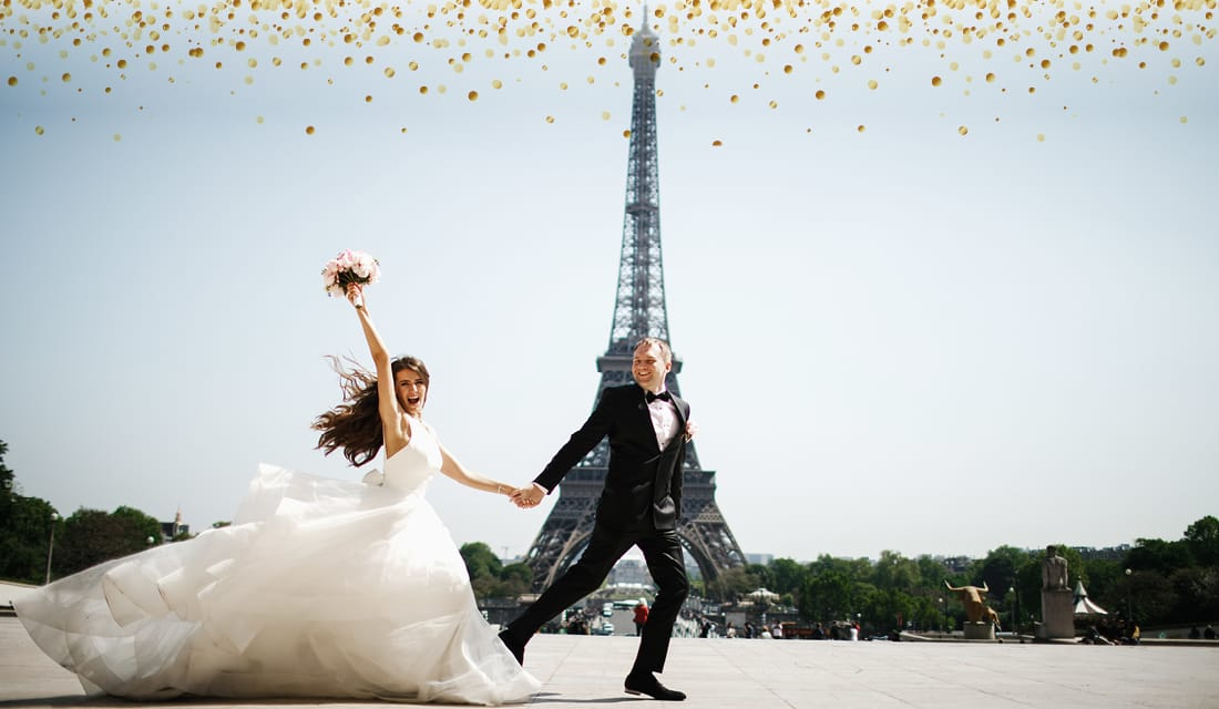 Happy bride and groom at Eiffel Tower the